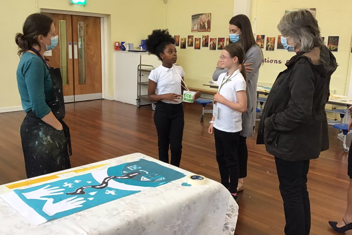 Bishop Cherry talks to children about art project